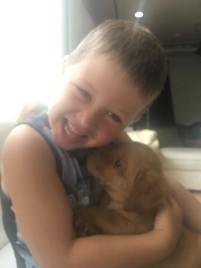 Declan getting puppy kisses
